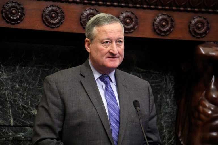 Philadelphia Mayor Jim Kenney stands behind a podium in the Mayor's Reception Room