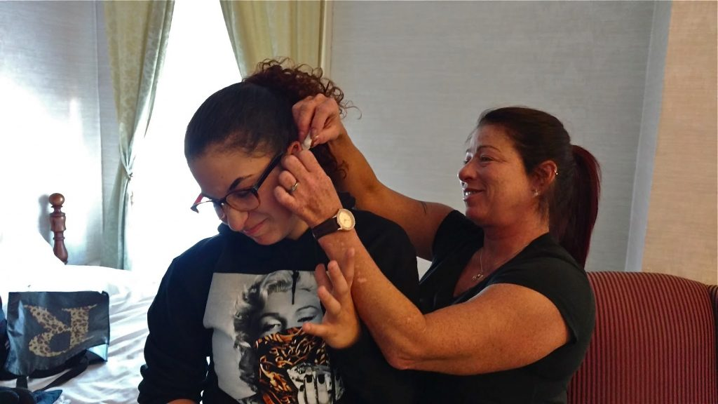 Redina Rodriguez tends to her daughter, Jordyn's piercing during a reunion in Williamsport, Pennsylvania.