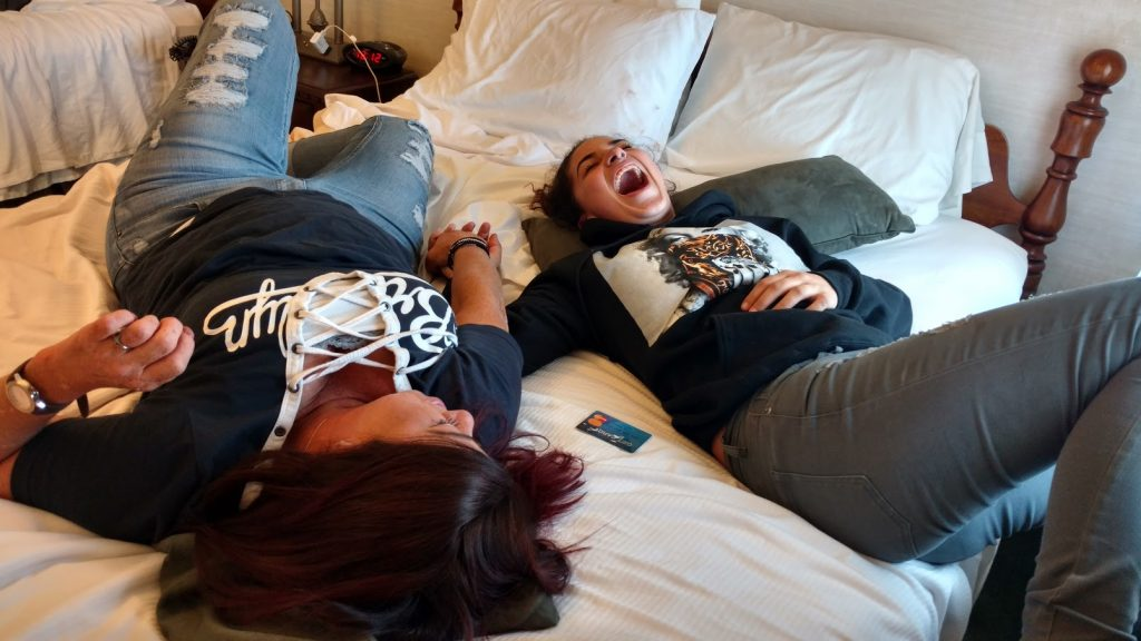 Redina Rodriguez and her daughter, Jordyn share a laugh during a reunion at a hotel in Williamsport, Pennsylvania.