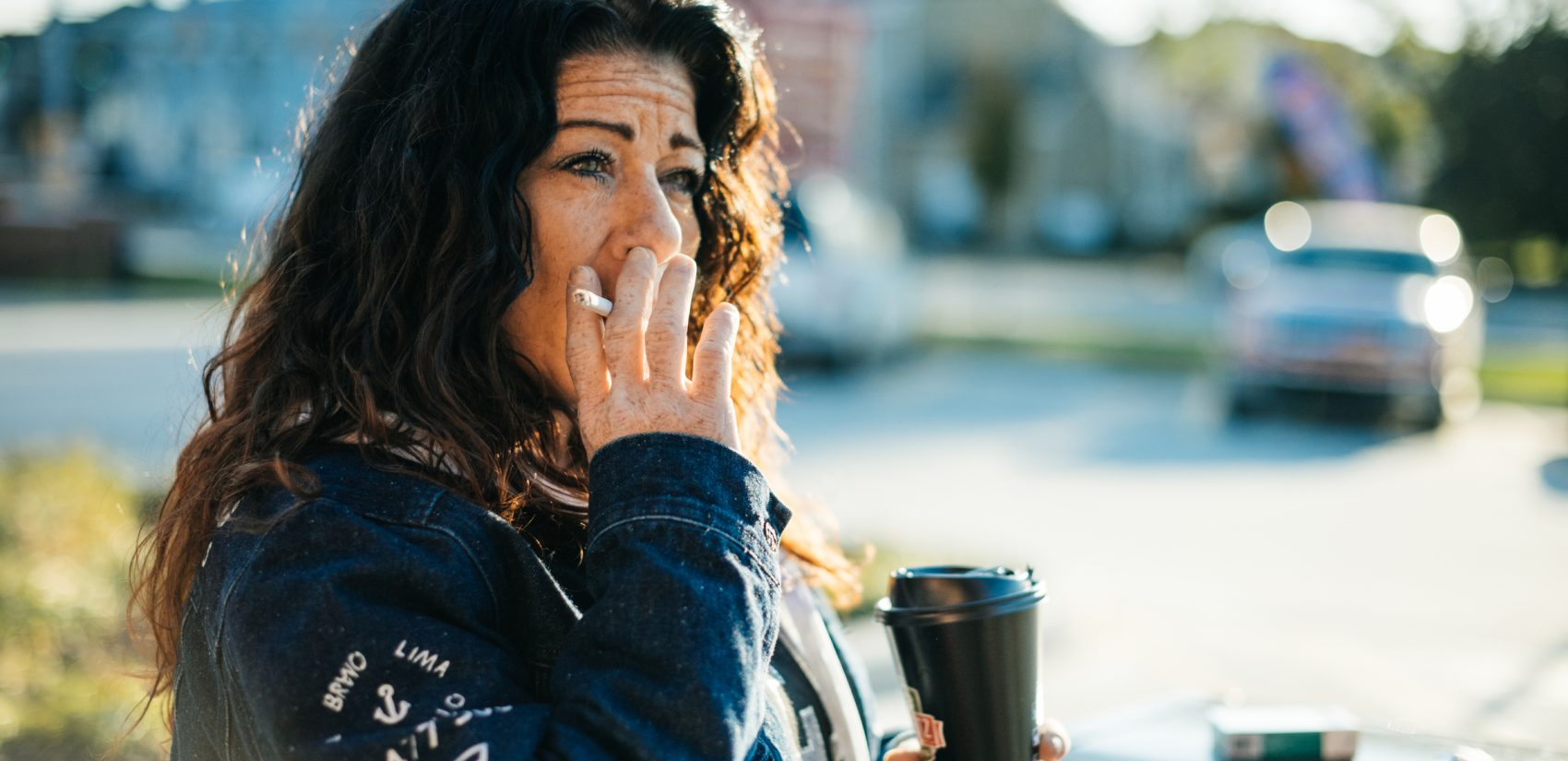 Redina pauses for a few minutes outside of the Sheetz in Shippensburg to sip her coffee and smoke a cigarette.