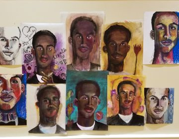 Portraits of the victims of gun violence hang on the walls at the chestnut hill presbyterian church
