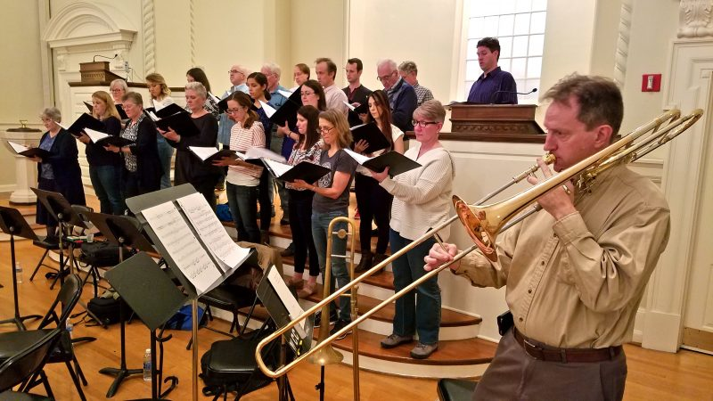 A trombone player and a choir rehearse at the Presbyterian Church of Chestnut Hill