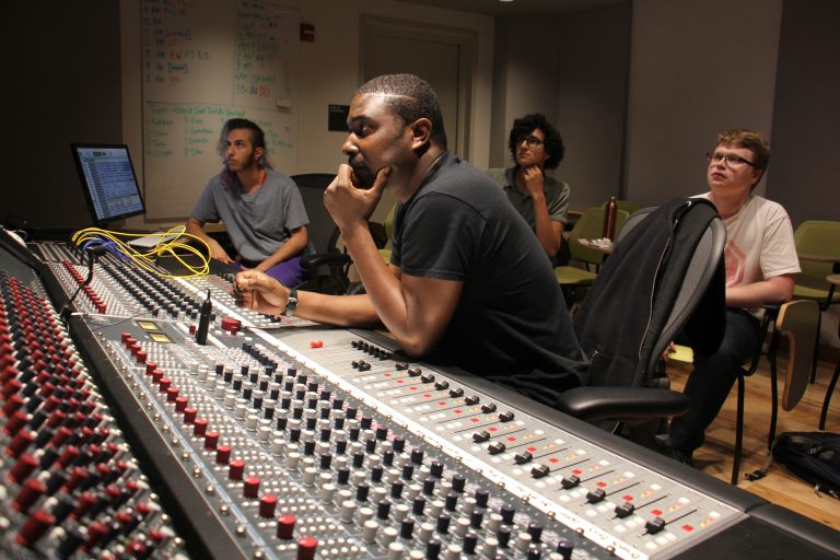 British musician Bitty McLean (center) works with Drexel students to remix tracks from the school's Sigma Sound archives