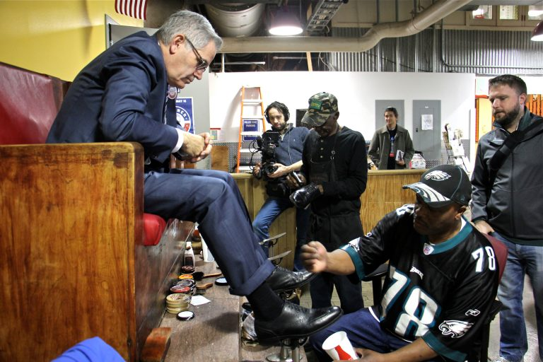District attorney candidate Larry Krasner sits for a shoeshine