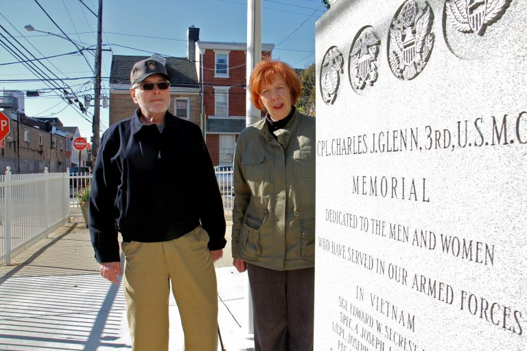 Jim Lonergan and Joyce Windfelder stand beside the Cpl. Charles J. Glenn Vietnam Veterans Memorial in Fishtown