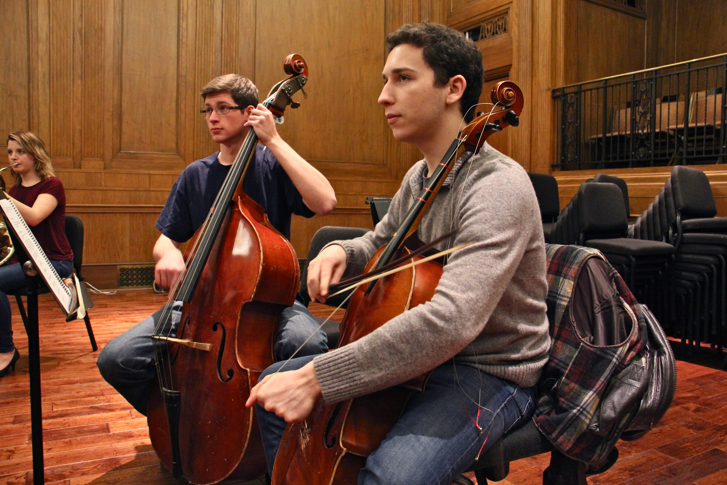 "Curtis Institute of Music students William Karns (left) and Oliver Herbert rehearse ""Symphony for a Broken Orchestra"" at the school's Field Concert Hall."