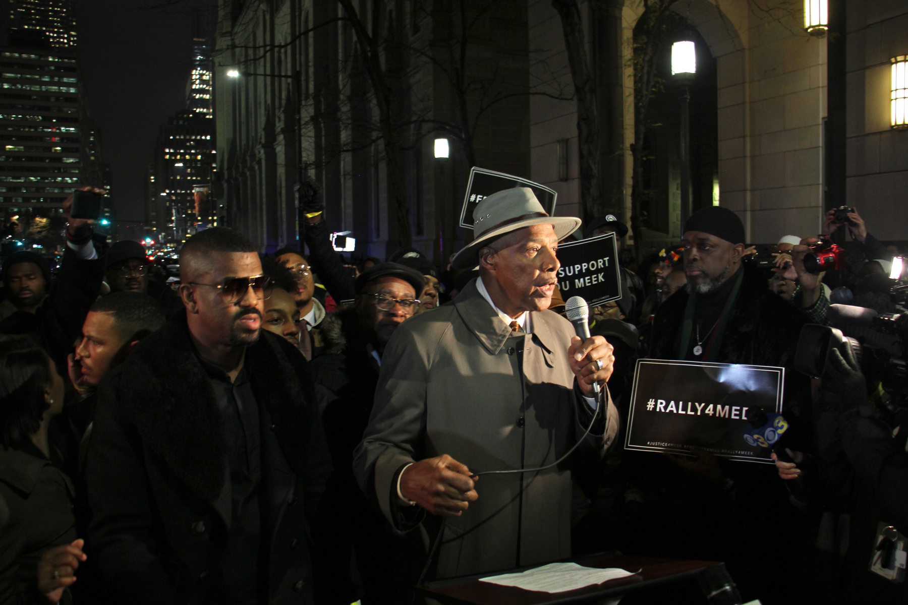 Basketball legend Julius Erving, better known as Dr. J, speaks in support of hip hop musician Meek Mill. He was one of a host of local celebrities who turned out for a rally outside the Center for Criminal Justice in Center City