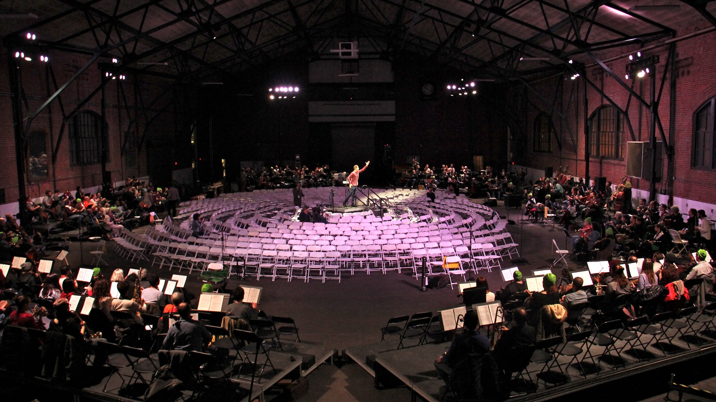 "The musicians will surround the audience during the performance of ""Symphony for a Broken Orchestra,"" at the Armory in Center City. Chairs are set for 575 audience members."