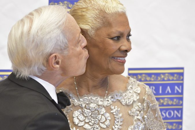 Event host Jerry Blavat and Marian Anderson Award recipient Dionne Warwick pose for photographers, ahead of a gala and award ceremony, on Tuesday, at the Kimmel Center. (Bastiaan Slabbers for WHYY)