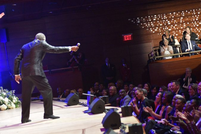 Billy Davis, Jr. holds out the mic as the spotlight hits Dionne Warwick at the Marian Anderson Award ceremony at the Kimmel Center, on Tuesday. (Bastiaan Slabbers for WHYY)