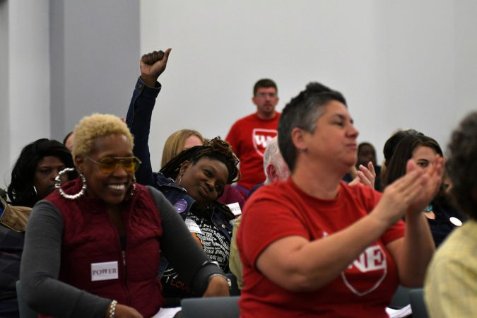 Attendees cheer during the monthly SRC meeting as they await the expected vote to resolve after a 16 year run. (Bastiaan Slabbers for WHYY)