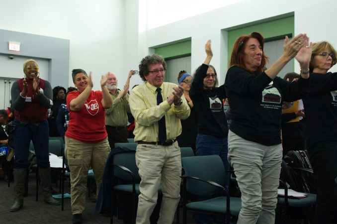 Attendees cheer after Councilwomen Bass and Gym address the SRC board members, during the November SRC meeting on Thursday. (Bastiaan Slabbers for WHYY)