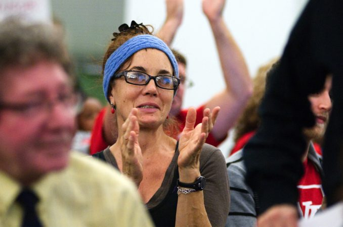 Attendees cheer during the monthly meeting of the School Reform Commission (Bastiaan Slabbers for WHYY)