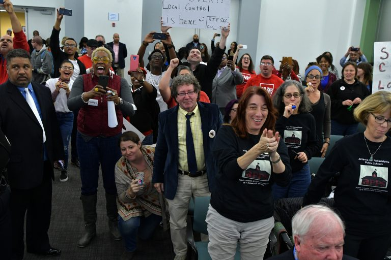 The crowd cheers as the SRC votes to dissolve itself after a marathon meeting Thursday.