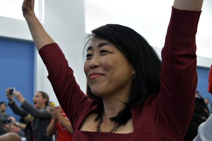 Councilwoman Helen Gym celebrates after the SRC votes itself out of function, after a marathon meeting on Thursday. (Bastiaan Slabbers for WHYY)