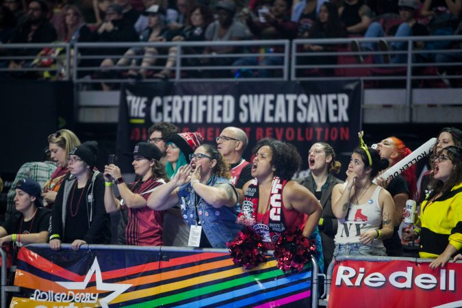 Fans cheer during the International WFTDA Championship at the Liacouras Center this weekend. (Brad Larrison for WHYY)