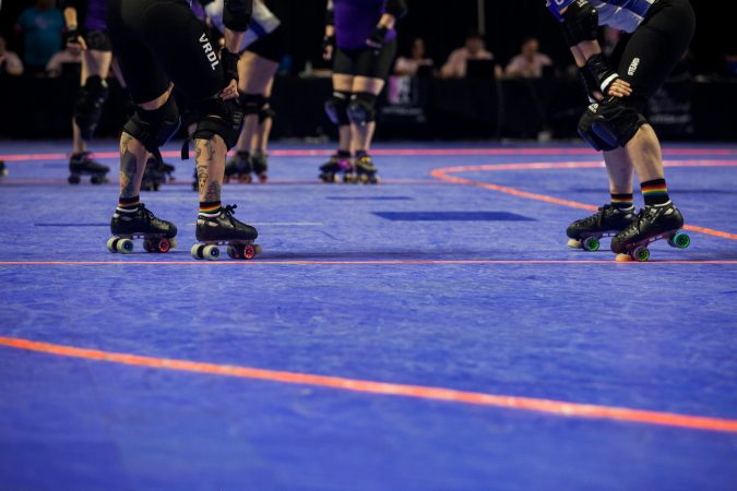 Players wait before restarting the WFTDA International Championship game at the Liacouras Center. (Brad Larrison for WHYY)