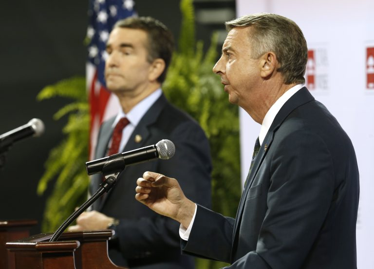Republican gubernatorial candidate Ed Gillespie, right, gestures during a debate with Democratic challenger Ralph Northam, left, during a debate at University of Virginia-Wise in Wise, Va., Monday, Oct. 9, 2017.