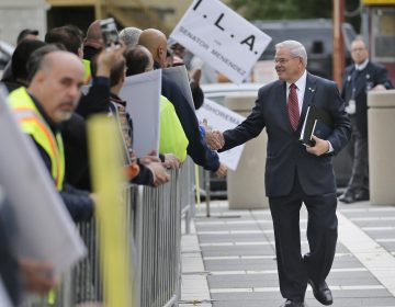 U.S. Sen. Bob Menendez greets supporters as he arrives to court in Newark, N.J., last month. (Seth Wenig/AP Photo)