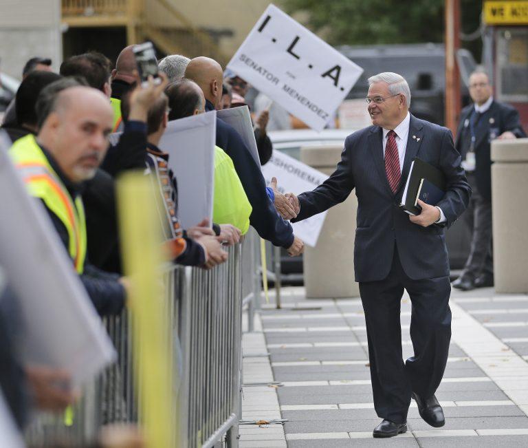 U.S. Sen. Bob Menendez greets supporters as he arrives to court in Newark, N.J., last month. (Seth Wenig/AP Photo)
