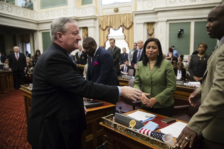 Philadelphia Mayor Jim Kenney, left, shakes hands with members of City Council after speaking at City Hall in Philadelphia. Kenney on Thursday called for the panel that governs the city's schools to be dissolved and replaced by mayor-appointed board.