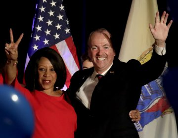 New Jersey Governor Elect Phil Murphy, right, and Lt. Gov. Elect Sheila Oliver wave to supporters