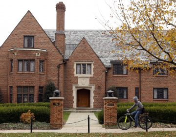 A bicyclist rides past Pennsylvania State University's shuttered Beta Theta Pi fraternity house Thursday, Nov. 9, 2017, in State College, Pa. Centre County, Pa., District Attorney Stacy Parks Miller announced Monday, Nov. 13, 2017, that more charges have been filed against fraternity brothers after investigators recovered deleted surveillance video footage recorded before the Feb. 4, 2017, death of 19-year-old Tim Piazza, of Lebanon, N.J., after a night of heavy drinking.
