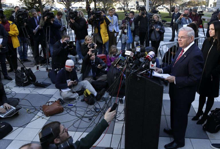 Democratic Sen. Bob Menendez speaks to reporters in front of the courthouse in Newark, N.J., Thursday, Nov. 16, 2017. The federal bribery trial of Menendez ended in a mistrial Thursday when the jury said it was hopelessly deadlocked on all charges against the New Jersey politician and a wealthy donor.