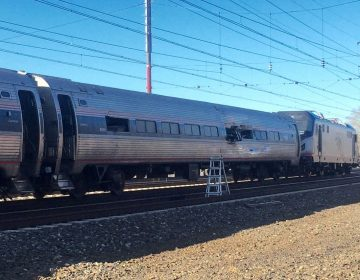 This photo shows an Amtrak train following a crash Sunday, April 3, 2016, in Chester, Pa. Amtrak said the train was heading from New York to Savannah, Ga., when it struck a backhoe outside of Philadelphia. (Glenn R. Hills Jr via A