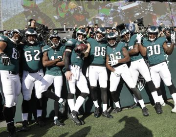 Philadelphia Eagles' Zach Ertz (86) poses with teammates after scoring a touchdown during the first half of an NFL football game against the Chicago Bears, Sunday, Nov. 26, 2017, in Philadelphia. (Michael Perez/AP Photo)