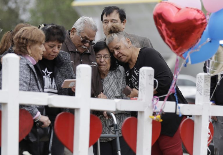 Family and friends gather around a makeshift memorial for the victims of the First Baptist Church shooting at Sutherland Springs Baptist Church, Friday, Nov. 10, 2017, in Sutherland Springs, Texas. A man opened fire inside the church in the small South Texas community on Sunday, killing more than two dozen. (Eric Gay/AP Photo)