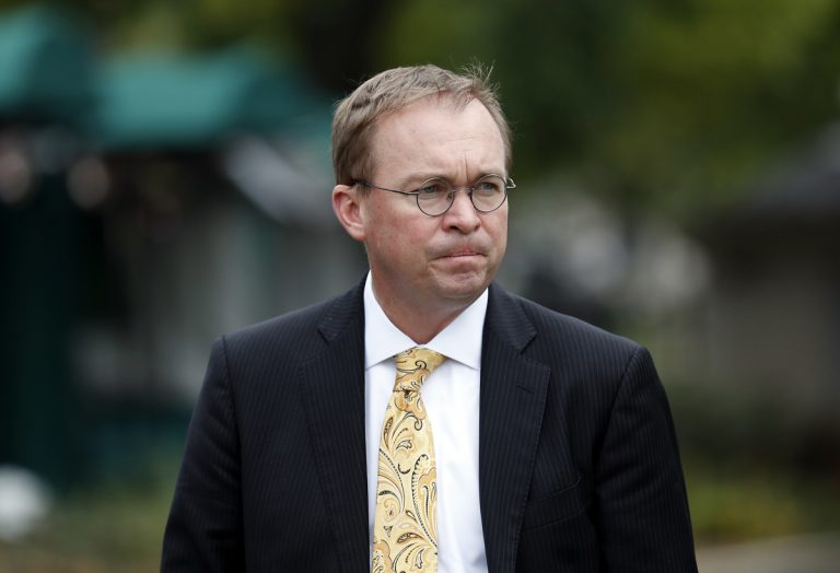 In this Sept. 13, 2017 file photo, Director of the Office of Management and Budget Mick Mulvaney departs after a television interview at the White House in Washington.  Senior Trump administration officials said Saturday, Nov. 25,  that they expect no trouble when President Donald Trump's pick for temporary director of the Consumer Financial Protection Bureau shows up for work, despite the clash on who should take over.   Trump announced he was picking Mulvaney within a few hours of Richard Cordray's announcement on Friday. (Alex Brandon/AP Photo, file)