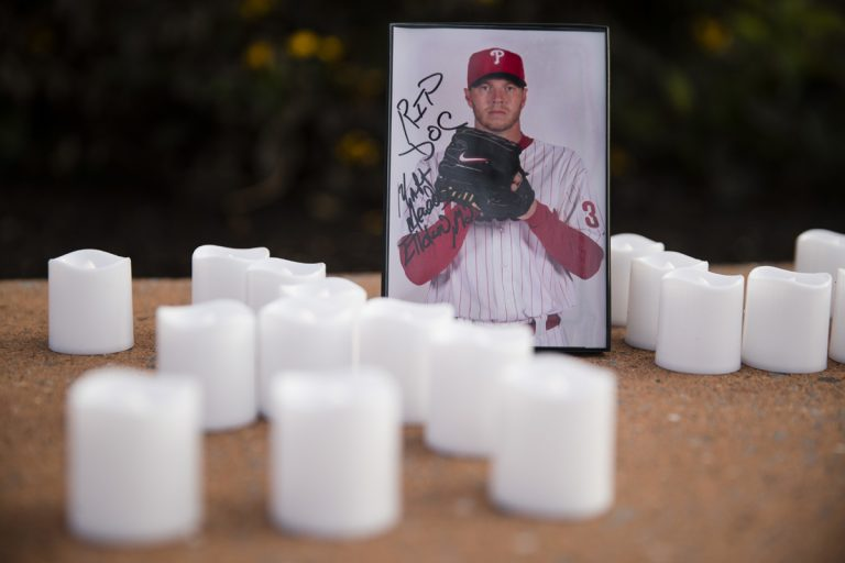 A memento is set in remembrance of former Phillies pitcher Roy Halladay outside Citizens Bank Park in Philadelphia, Wednesday, Nov. 8, 2017. Halladay, a two-time Cy Young Award winner who pitched a perfect game and a playoff no-hitter for the Phillies, died when his private plane crashed into the Gulf of Mexico. He was 40. (Matt Rourke/AP Photo)