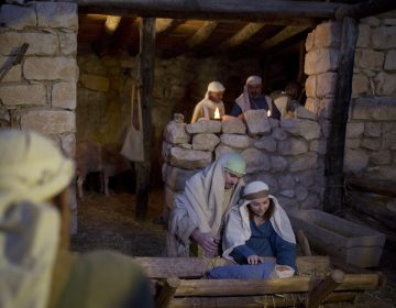 In this Tuesday, Dec. 22, 2015 file photo, Christian actors play the parts of Joseph and Mary during a re-enactment of a Nativity scene of the birth of Jesus Christ as part of Christmas festivities at the Nazareth Village in the northern Israeli city of Nazareth. (Ariel Schalit/AP Photo, file)