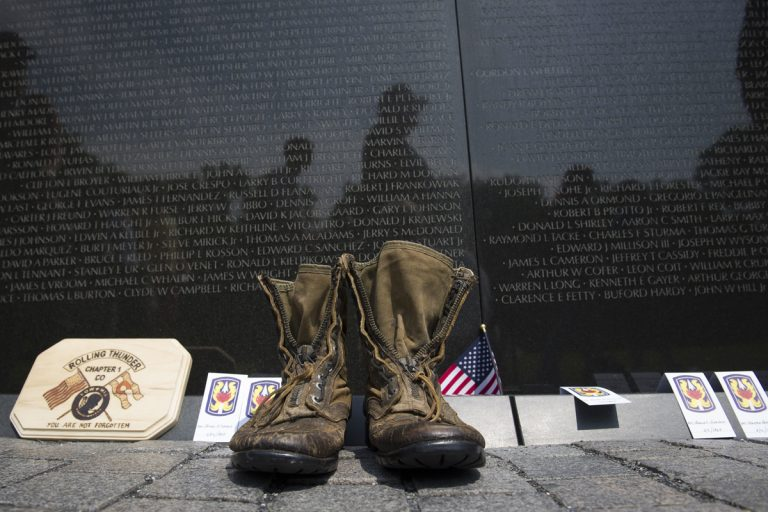 A pair of military boots are left at the Vietnam Veterans Memorial during the 30th anniversary of the Rolling Thunder 'Ride for Freedom' demonstration in Washington, Sunday, May 28, 2017. (Cliff Owen/AP Photo)