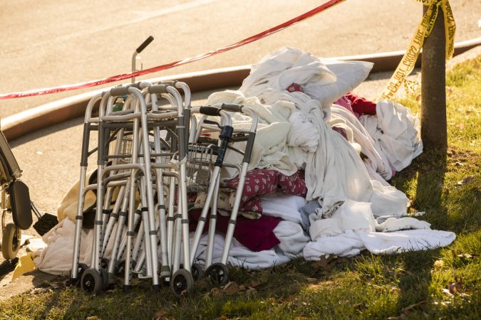 A pile of blankets and walkers set by the side of the road are seen in the aftermath of a fire at the the Barclay Friends Senior Living Community in West Chester, Pa., Friday, Nov. 17, 2017.   At least 20 people have been injured in a massive fire at the senior living community about 35 miles west of Philadelphia. (Matt Rourke/AP Photo)