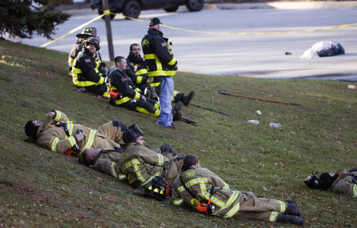 Firefighters rest in the aftermath of a fire at the the Barclay Friends Senior Living Community in West Chester, Pa., Friday, Nov. 17, 2017.  At least 20 people have been injured in a massive fire at the senior living community about 35 miles west of Philadelphia. (Matt Rourke/AP Photo)