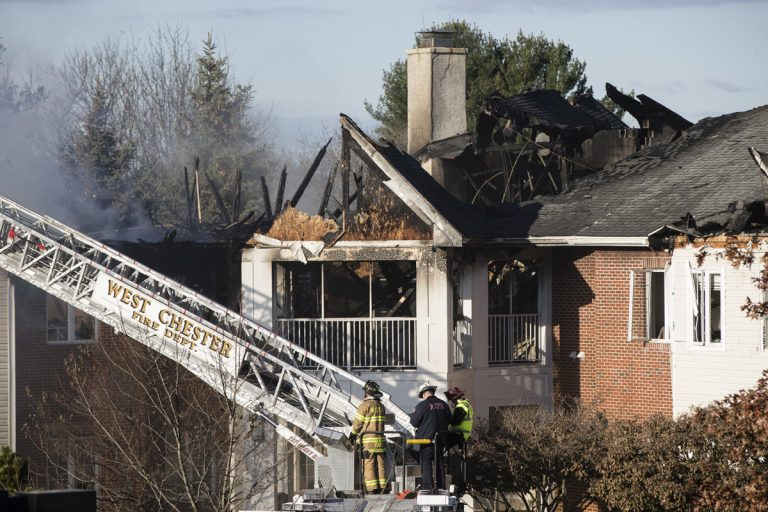 Firefighters continue to work the scene of a fire at the the Barclay Friends Senior Living Community in West Chester, Pa., Friday, Nov. 17, 2017. (