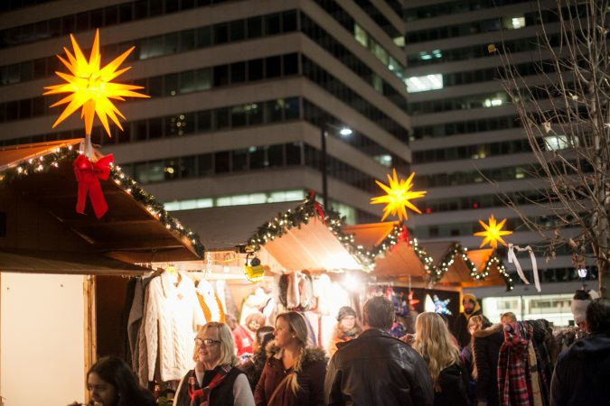 Shoppers browse stands at the Christmas Village at LOVE Park Friday. (Brad Larrison for WHYY)