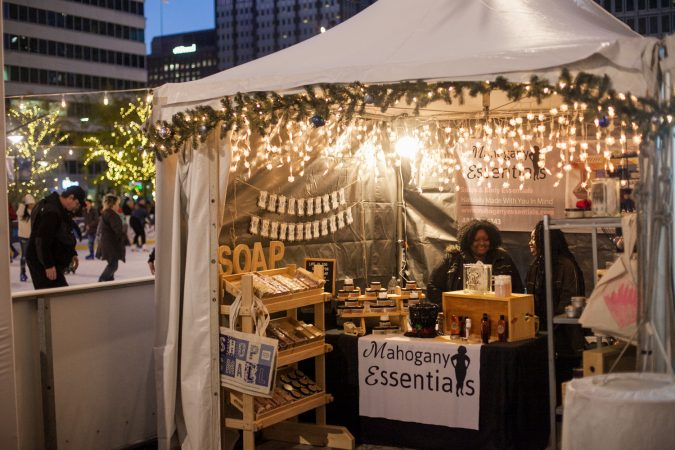 The Mahogany Essentials stand sells soaps and body essentials near the ice skating rink at Dilworth Park Friday. (Brad Larrison for WHYY)