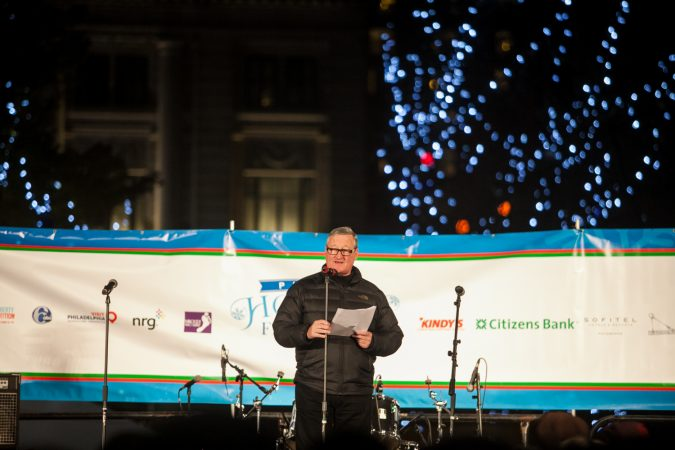 Philadelphia Mayor Jim Kenney reads The Night Before Christmas before the lighting of the Christmas tree outside of City Hall Friday. (Brad Larrison for WHYY)