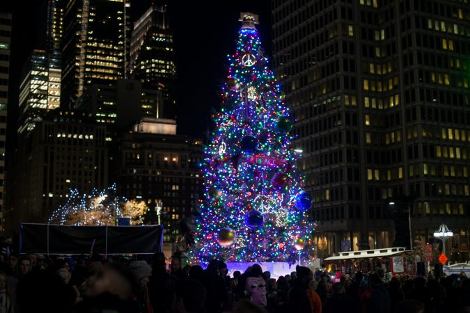 The lit Christmas tree outside of City Hall Friday evening. (Brad Larrison for WHYY)