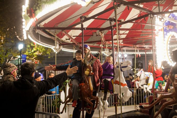 A carousel installed in the City Hall courtyard for the Christmas Village. (Brad Larrison for WHYY)