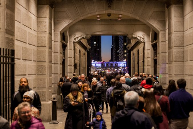The City Hall Christmas tree lighting ceremony and Christmas Village drew thousands to Center City Friday evening. (Brad Larrison for WHYY)