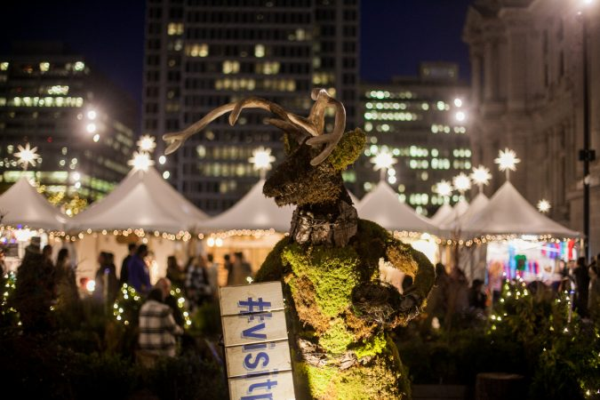 A reindeer made of plants is a featured decoration in the garden maze at Dilworth Park. (Brad Larrison for WHYY)