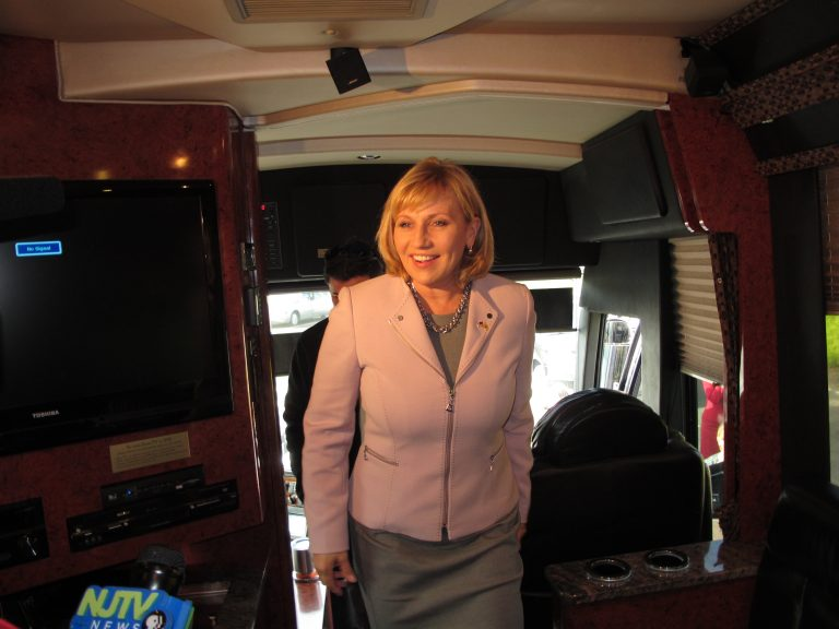 New Jersey Lt. Gov. Kim Guadagno, the Republican candidate for governor in Tuesday's election, sets off on her bus tour Thursday. (Phil Gregory/WHYY)