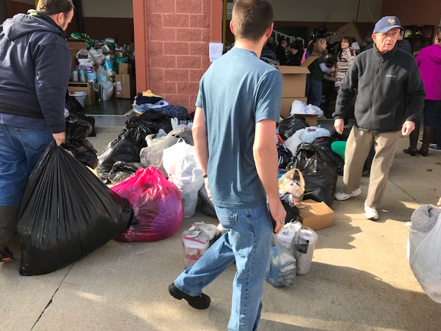 Volunteers at Good Will Fire Company No. 2 help sort through donations for residents displaced by the five-alarm fire at Barclay Friends Senior Living Community in West Chester, Pa. (Shai Ben-Yaacov, WHYY)
