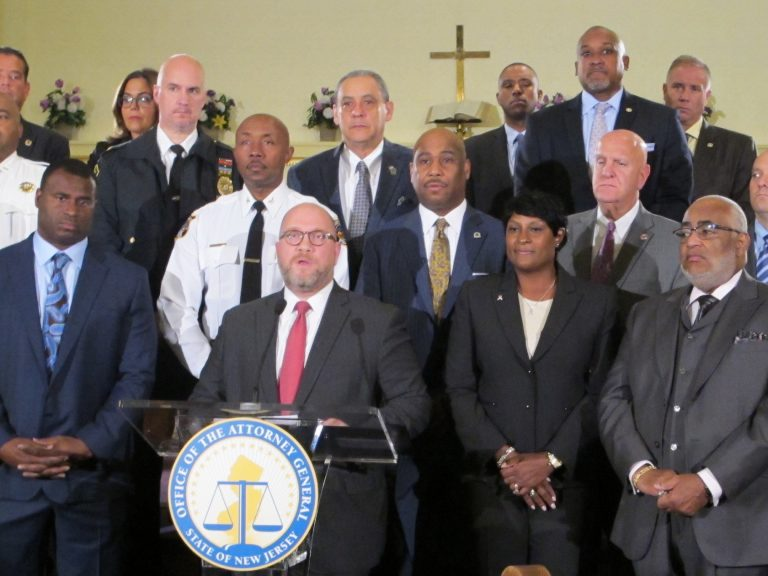 Joined by law enforcement and community leaders , New Jersey Attorney General Christopher Porrino announces the