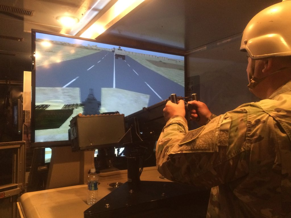 The military uses video game technology in recruitment as well, like this Humvee simulator where you can shoot enemies on a screen with a machine gun.