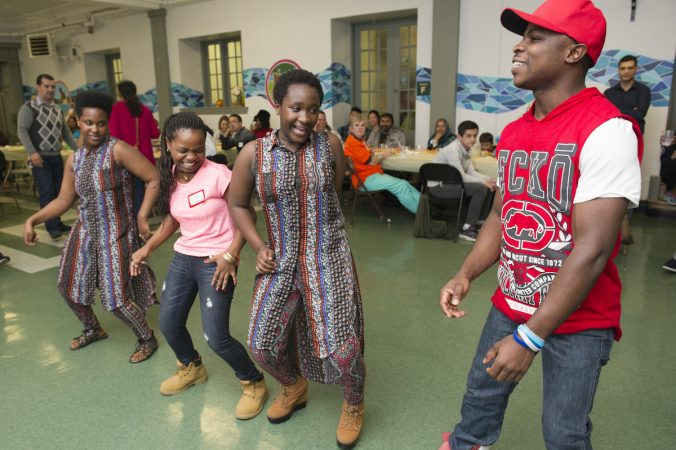 Bandu Pascal Lubria right, a refugee from the Democratic Republic of Congo dances with fellow refugees doing an African dance. (Jonathan Wilson for WHYY)
